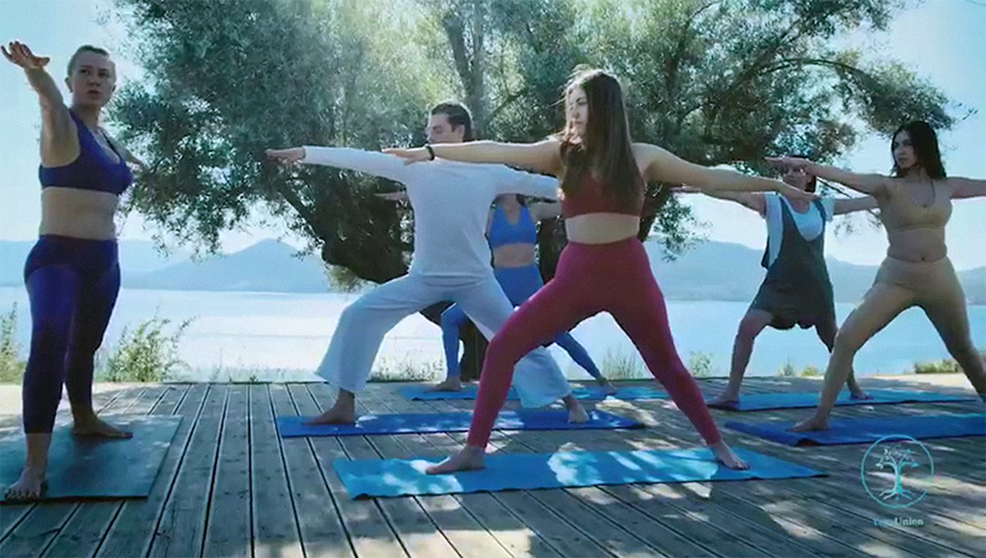 Yoga session on the foodpath deck in palairos